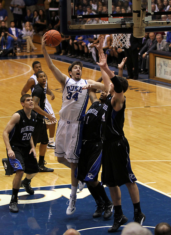 Ryan Kelly shoots past Belmont defense.Duke beat Presbyterian 96-55 on Saturday, November 12, 2011 at Cameron Indoor Stadium in Durham, NC. It was win number 902 for Duke head coach Mike Krzyzewski, tying him with Bob Knight for the NCAA Division I all-time win record. Photo by Al Drago.