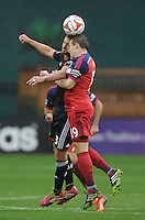 Washington, D.C.- March 29, 2014. Harry Shipp of the Chicago Fire heads the ball against Perry Kitchen (23) of D.C. United. The Chicago Fire tied D.C. United 2-2 during a Major League Soccer Match for the 2014 season at RFK Stadium.