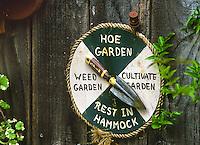 Whimsical garden sign, humorous work indicator dial