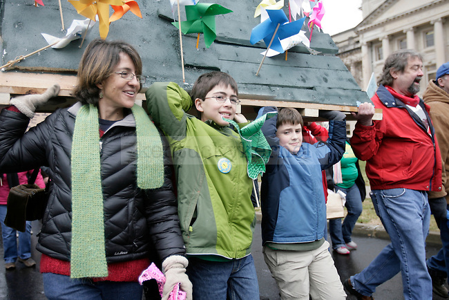 Protesters marched from the Capitol to the Governer's Mansion at I Love Mountains Day at the Kentucky State Capitol in Frankfort, Ky., on Tuesday, Feb. 14, 2012. Pinwheels were stuck in a model mountain and it was carried during the march. Photo by Tessa Lighty | Staff