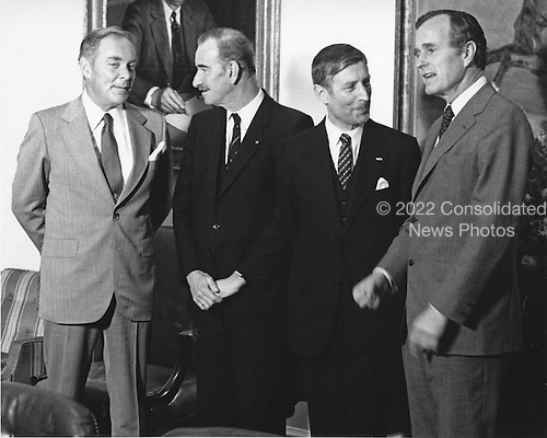 """United States Vice President George H.W. Bush, right, and U.S. Secretary of State Alexander Haig, left, meet Minister of Foreign Affairs Chris van der Klaauw, center left, and Prime Minister Andreas A.M. """"Dries"""" van Agt of the Netherlands at the White House in Washington, D.C. on March 31, 1981.  Bush has temporarily taken over the duties of the Chief Executive following the assassination attempt on U.S. President Ronald Reagan the day before.<br /> Credit: Benjamin E. """"Gene"""" Forte / CNP"""