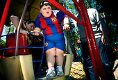 Dzhambulat Khotokhov, 6, one of the fattest boys in the world, gets off a ferris wheel in Nal'chik, in southern Russia. Now 1.4 metres tall and weighing about 100 kg, Khotokhov has grabbed world attention as the biggest kid in the world since he was three. .Khotokhov lives with his mother Neyla and his brother, 14-year-old Mukha. .