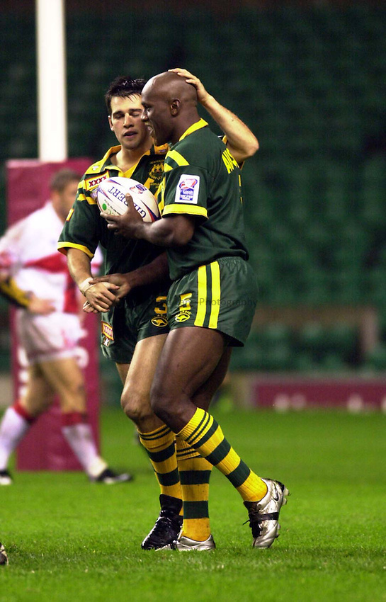 Photo Ken Brown.28.10.2000 England v Australia - Rugby League World Cup.Wendell Sailor is congratulated by Naylor after his try
