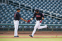 AZL Indians third baseman Henry Pujols (28) is congratulated by manager Anthony Medrano (8) after hitting a home run against the AZL Rangers on August 26, 2017 at Goodyear Ball Park in Goodyear, Arizona. AZL Indians defeated the AZL Rangers 5-3. (Zachary Lucy/Four Seam Images)