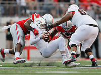 Ohio State Buckeyes defensive lineman Adolphus Washington (92) sacks Northern Illinois Huskies quarterback Drew Hare (12) with the help of Ohio State Buckeyes linebacker Raekwon McMillan (5) during the fourth quarter of the NCAA football game at Ohio Stadium in Columbus on Sept. 19, 2015. (Adam Cairns / The Columbus Dispatch)
