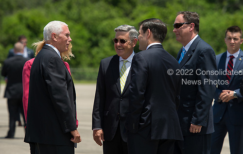 In this photo released by the National Aeronautics and Space Administration (NASA) United States Vice President Mike Pence, left, greets Acting NASA Administrator Robert Lightfoot, right, and Director, Kennedy Space Center, Robert Cabana, second from left, with US Senator Marco Rubio (Republican of Florida), center, after arriving at the Shuttle Landing Facility (SLF) to highlight innovations made in America and tour some of the public/private partnership work that is helping to transform Kennedy Space Center (KSC) into a multi-user spaceport on Thursday, July 6, 2017 in Cape Canaveral, Florida. <br /> Mandatory Credit: Aubrey Gemignani / NASA via CNP