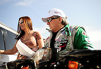Feb. 19, 2010; Chandler, AZ, USA; NHRA funny car driver John Force (right) with wife Laurie Force during qualifying for the Arizona Nationals at Firebird International Raceway. Mandatory Credit: Mark J. Rebilas-