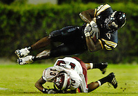 Florida International University Golden Panthers (0-5, 0-1 SBC)  versus the Troy University Trojans (3-2, 2-0 SBC) at the Orange Bowl, Miami, Florida on Saturday, October 6, 2007.  The Trojans defeated the Golden Panthers, 34-16...FIU junior tight end Moses Hinton (89) (Delray Beach, Fla.) goes airborne after colliding with Troy defensive back Elbert Mack (13) in the third quarter.