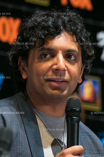 """Director M. Night Shyamalan speaks during the talk show of the mystery drama """"Wayward Pines"""" at the United Cinemas in Toyosu area on May 21, 2015, Tokyo, Japan. Dillon and Shyamalan are in Japan to promote simultaneous worldwide launch of the mystery drama through the FOX channel. Wayward Pines is an American television series based on the novel Pines by Blake Crouch. (Photo by Rodrigo Reyes Marin/AFLO)"""