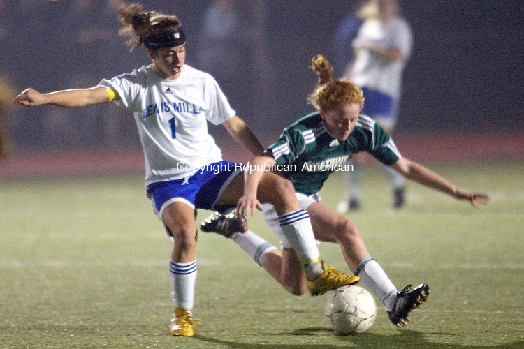ROCKY HILL, CT. 16 November 2010-111610SV07--&nbsp;#1 Lindsay Mur of Lewis Mills battles for the ball with #6 Emily Kearney of Northwest Catholic during CIAC semifinal soccer action in Rocky Hill Tuesday.<br /> Steven Valenti Republican-American
