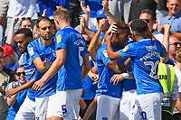 Goalscorer Jamal Lowe of Portsmouth is mobbed after scoring the first goal during Portsmouth vs Luton Town, Sky Bet EFL League 1 Football at Fratton Park on 4th August 2018