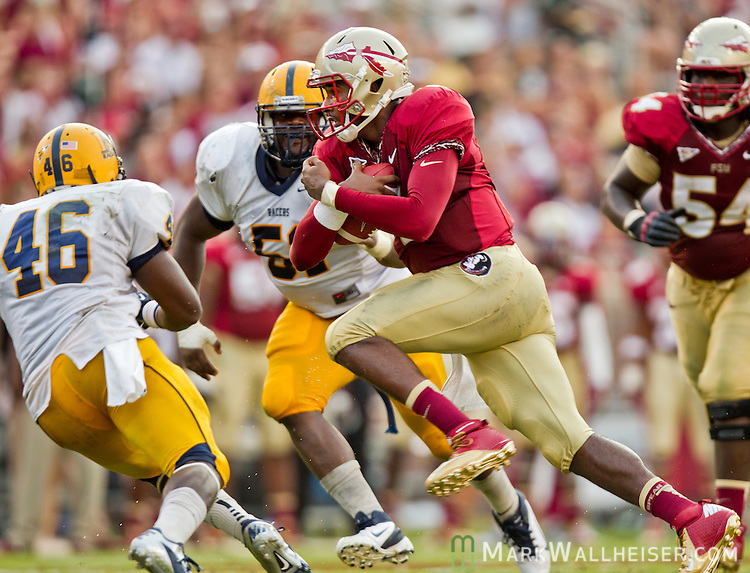 FSU quarterback E.J. Manual scrambles in the first half against Murray State when the Florida State Seminoles defeated the Murray State Racers 69-3 in their first NCAA football game of the 2012 season at Doak Campbell Stadium on the FSU campus in Tallahassee, Florida September 1, 2012.