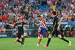 Atletico de Madrid´s Adrian (C) and FC Barcelona´s Jordi Alba (L) during a second leg quarterfinal Champions League soccer match between Atletico de Madrid and FC Barcelona at Vicente Calderon stadium in Madrid, Spain. April 09, 2014. (ALTERPHOTOS/Victor Blanco)