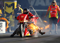 Jun 16, 2017; Bristol, TN, USA; NHRA top fuel nitro Harley Davidson rider Chris Smith explodes an engine on fire during qualifying for the Thunder Valley Nationals at Bristol Dragway. Mandatory Credit: Mark J. Rebilas-USA TODAY Sports