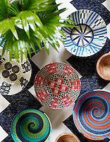 Interior in London. Patterned bowls photographed from above, placed on hand woven rug. Styling by Alison Nicholls.