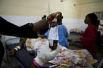 Nurse Adimire brings more blood from the blood bank, Mommy's third pint. Mommy delivered and died from postpartum bleeding at the PCMH (Princess Christian Memorial Hospital) , Freetown, Sierra Leone.