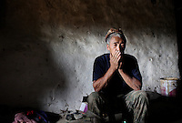 A Tibetan man in a village in the region of Aba. South-east Tibetan Plateau, in Sichuan Province, western China.