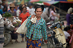 A woman walks through the Tahan Market in Kalay, a town in Myanmar. This market is located in Tahan, the largely ethnic Chin section of the town.