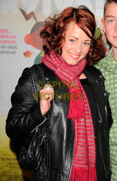 "SARAH CAWOOD.""The Science Of Survival"" private view, Science Museum, London, England..April 3rd, 2008.half length black leather jacket bag purse ring pink red scarf .CAP/CAN.©Can Nguyen/Capital Pictures."