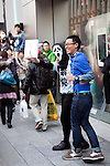 March 16, 2012, Tokyo, Japan - Satisfied customers come out with new Apple tablets..Fans lined up overnight outside the Apple store in Ginza, to buy the new iPad. Japan was one of the first countries where Apple fans could get their hands on the new iPad.