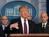 United States President Donald J. Trump speaks about border security in the White House briefing room in Washington, DC, January 3, 2019. Standing with Trump are members of agencies associated with border security.  Credit: Chris Kleponis / CNP/AdMedia