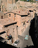 ITALY, Orvieto, Umbria, cars on street with houses on both side of street.