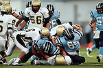 Torrance, CA 09/10/10 - Haden Gregory (Peninsula #42), Justin Rodriguez (North #65), Blake Allman (Peninsula #77), Benjamin Brown (North #5) and Matt Hezlep (Peninsula #6)  in action during the Peninsula Panthers-North Saxons Varsity football game at North Torrance High School.