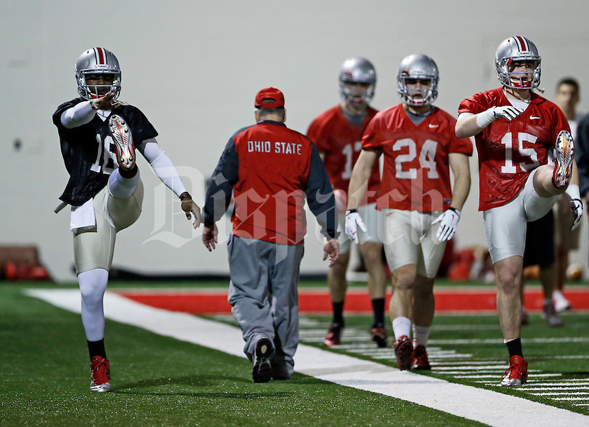 Ohio State Buckeyes quarterback J.T. Barrett (16) stretches prior to the team's first practice of spring football at the Woody Hayes Athletic Center on March 10, 2015. (Adam Cairns / The Columbus Dispatch)