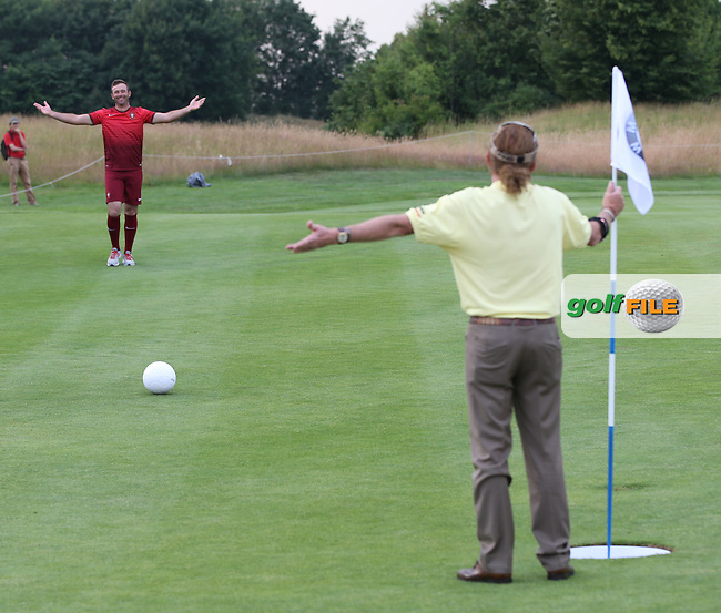 Ricardo Santos (POR) asks for some help from Miguel Angel Jimenez (ESP) during the Foot Golf Challenge at the Opening Show Event of the BMW International Open 2014 from Golf Club Gut Lärchenhof, Pulheim, Köln, Germany. Picture:  David Lloyd / www.golffile.ie