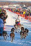 Cindy Abbott starting Iditarod 2014, Willow, Southcentral Alaska, Winter.