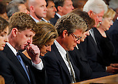 "Boston, MA - August 29, 2009 -- U.S. Senator Edward M. ""Ted"" Kennedy's son Congressman Patrick Kennedy, daughter Kara Kennedy Allen, son Edward Kennedy Jr., his widow Vicki Reggie Kennedy, former President Bill Clinton and Secretary of State Hillary Clinton. during funeral services for U.S. Senator Edward Kennedy at the Basilica of Our Lady of  Perpetual Help in Boston, Massachusetts August 29, 2009.  Senator Kennedy died late Tuesday after a battle with cancer.   .Credit: Brian Snyder- Pool via CNP"