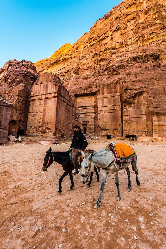 Bedouin man with his donkeys, Petra Archaeological Park, Petra, Jordan.