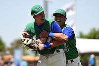 Lexington Legends catcher Luis Villegas (15) hugs first baseman Frank Schwindel (13), who got the game winning hit, after a game against the Hagerstown Suns on May 19, 2014 at Whitaker Bank Ballpark in Lexington, Kentucky.  Lexington defeated Hagerstown 10-8.  (Mike Janes/Four Seam Images)