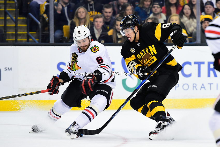 Friday, January 20, 2017: Chicago Blackhawks defenseman Michal Kempny (6) tries to block Boston Bruins right wing David Pastrnak (88)  during the National Hockey League game between the Chicago Blackhawks and the Boston Bruins held at TD Garden, in Boston, Mass. Chicago defeats Boston 1-0 in regulation time. Eric Canha/CSM