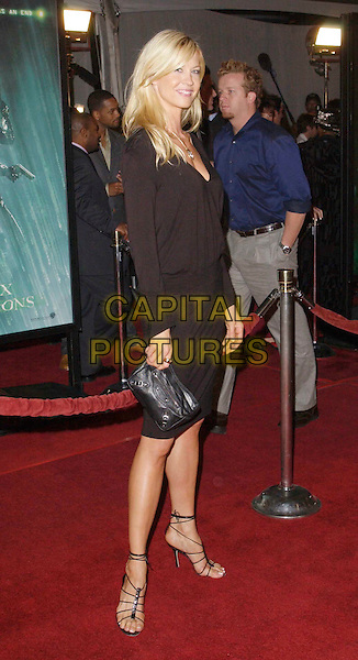 JENNA ELFMAN.attends the Warner Brothers L.A. Premiere of The Matrix Revolutions held at The Walt Disney Concert Hall. .little black dress, strappy sandals, full length, full-length.www.capitalpictures.com.sales@capitalpictures.com.©Capital Pictures.