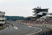LE MANS, FRANCE - JUNE 11: The race-winning Sauber-Mercedes C9/88 88-C9-03 of Jochen Mass, Manuel Reuter and Stanley Dickens is driven past the pit lane and front straight grandstand during the 24 Hours of Le Mans at the Circuit de la Sarthe in Le Mans, France, on June 11, 1989.
