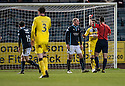 Dundee's Paul McGinn (19) is sent off after he brings down St Mirren's Kenny McLean for the penalty.