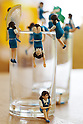 "Different kinds of ""Cup no Fuchiko"" climb on the side of a glass on August 19, 2014 in Tokyo, Japan. These mini figures are popular amongst young Japanese women who often use them when composing pictures of their lunch. The name Cup no Fuchiko translates to  or ""office lady, or OL, on the side of a cup"" and the figures are sold as drink ornaments. Made by  Kitan Club CO. LTD Cup no Fuchiko was created by the manga artist Katsuki Tanaka. There are currently 21 models of Cup no Fuchiko and Kitan Club has also made capsule toys from famous characters such as Street Fighter II, Moomin, Hello Kitty. (Photo by Rodrigo Reyes Marin/AFLO)"