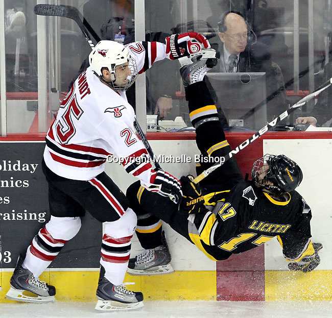 UNO's Brent Gwidt  sends Michigan Tech's Mikael Lickteig to the ice during the third period. UNO defeated Michigan Tech 5-2 Thursday night at Qwest Center Omaha. (Photo by Michelle Bishop)