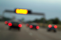 Blurred tail lights of cars travelling on a highway, Paris, France.