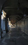 Arcade of shuttered shops, Rialto market, Venice, Italy.