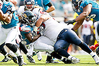 November 27, 2011:  Jacksonville Jaguars running back Deji Karim (35) is tackled by Houston Texans nose tackle Shaun Cody (95) during first half action between the Jacksonville Jaguars and the Houston Texans played at EverBank Field in Jacksonville, Florida.  ........