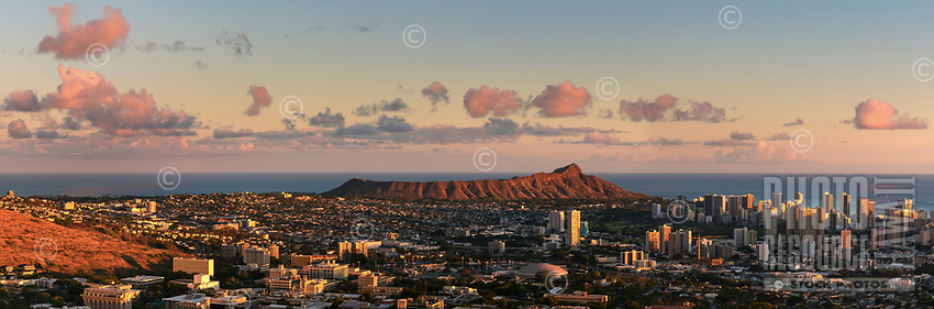 Late afternoon sunlight glows over Diamond Head, with Manoa in the foreground and Waikiki on the right, seen from Tantalus, Honoluiu, O'ahu.