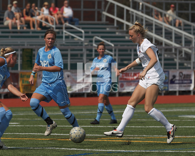 Boston Aztec forward Lucy Gildein (27) flicks a pass. In a Women's Premier Soccer League (WPSL) match, Boston Aztec (white) defeated Seacoast United Mariners (blue), 2-1, at North Reading High School Stadium on Arthur J. Kenney Athletic Field on on June 23, 2013. Due to injuries through the season, Seacoast United Mariners could only field 10 players.