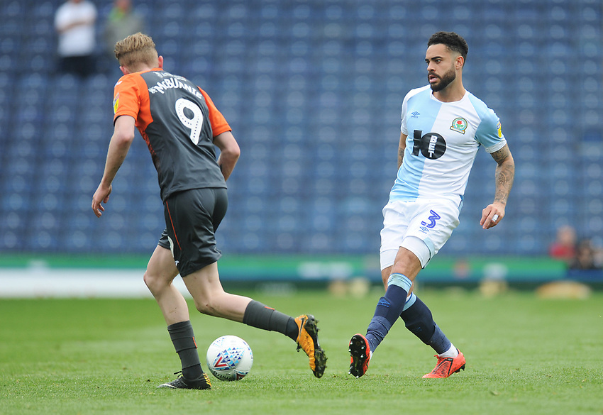 Blackburn Rovers' Derrick Williams under pressure from Swansea City's Oli McBurnie<br /> <br /> Photographer Kevin Barnes/CameraSport<br /> <br /> The EFL Sky Bet Championship - Blackburn Rovers v Swansea City - Sunday 5th May 2019 - Ewood Park - Blackburn<br /> <br /> World Copyright © 2019 CameraSport. All rights reserved. 43 Linden Ave. Countesthorpe. Leicester. England. LE8 5PG - Tel: +44 (0) 116 277 4147 - admin@camerasport.com - www.camerasport.com