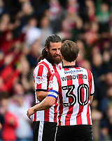 Lincoln City's Michael Bostwick, left, celebrates scoring the opening goal with team-mate Alex Woodyard<br /> <br /> Photographer Chris Vaughan/CameraSport<br /> <br /> The EFL Sky Bet League Two - Lincoln City v Chesterfield - Saturday 7th October 2017 - Sincil Bank - Lincoln<br /> <br /> World Copyright &copy; 2017 CameraSport. All rights reserved. 43 Linden Ave. Countesthorpe. Leicester. England. LE8 5PG - Tel: +44 (0) 116 277 4147 - admin@camerasport.com - www.camerasport.com