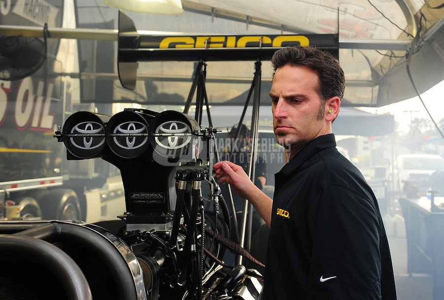 Jan. 17, 2012; Jupiter, FL, USA: Aaron Brooks crew chief for NHRA top fuel dragster driver Morgan Lucas (not pictured) during testing at the PRO Winter Warmup at Palm Beach International Raceway. Mandatory Credit: Mark J. Rebilas-