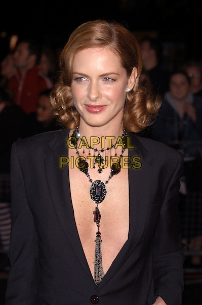 TRINNY WOODALL .arrives at Albert Hall for the National Television Awards 2002.Ref: PL.www.capitalpictures.com.sales@capitalpictures.com.©Capital Pictures.necklace, plunging neckline, hair