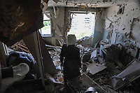 A woman inside her flat destroyed by the Ukrainian forces shelling on Kramatorsk on 02 July 2014, Ukraine