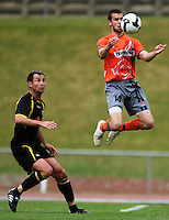 Waikato's Daniel Peat controls the ball under pressure from Michael Winsauer..NZFC soccer  - Team Wellington v Waikato FC at Newtown Park, Wellington. Sunday, 20 December 2009. Photo: Dave Lintott/lintottphoto.co.nz